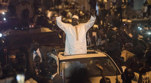 New president Adama Barrow arrives in the Westfield area of Serrekunda in Gambia (AP/Sylvain Cherkaoui)