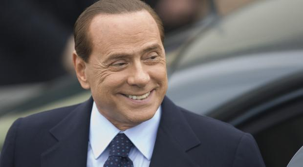 Silvio Berlusconi is to face corruption charges