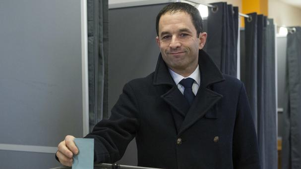 Benoit Hamon casts his ballot as part of the second round of the primaries in Trappes (AP)
