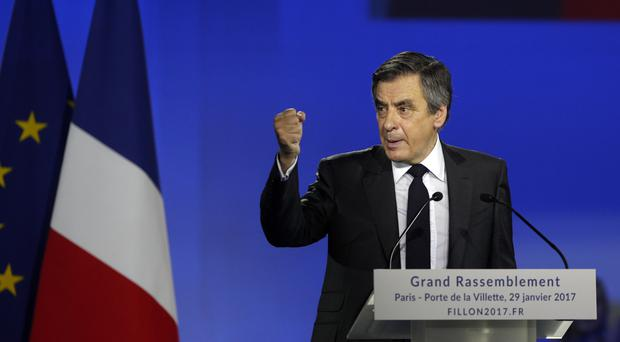 Francois Fillon has denied claims his wife received money for a job she did not do (AP)