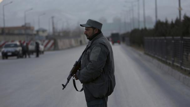 A member of the Afghan security forces stands guard in Kabul (AP)