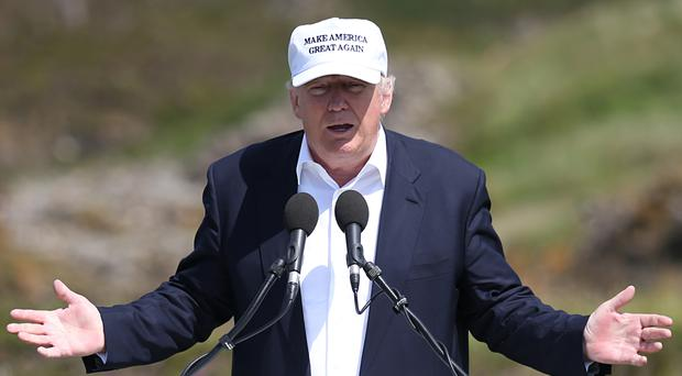 District Judge Kenneth Marra ruled on Wednesday that Trump National Golf Club violated contracts the members had signed with the previous owner, Ritz-Carlton