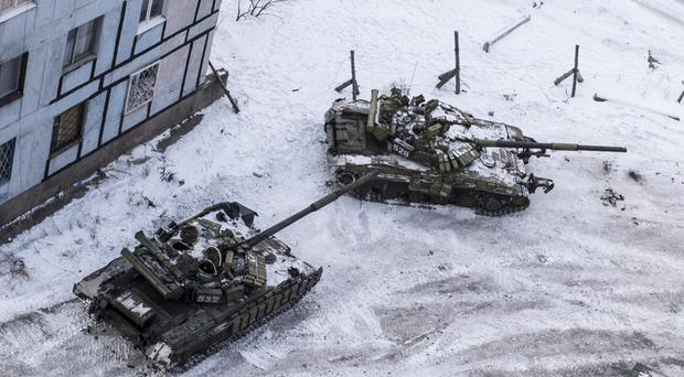 Ukrainian tanks in the yard of an apartment block in Avdiivka, eastern Ukraine (AP)