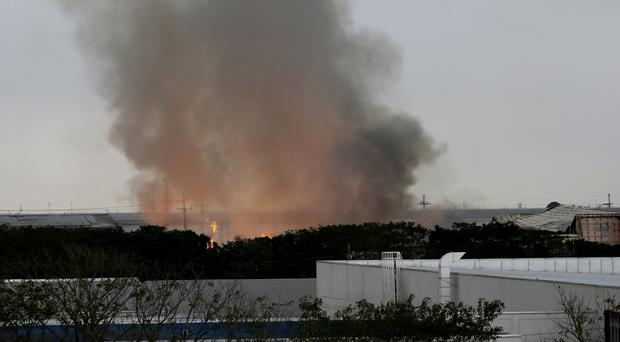A huge fire burns at House Technology Industries in General Trias township, Cavite province (AP)