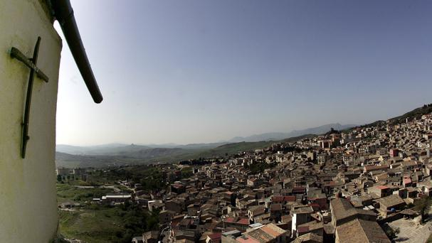 A crucifix towers over Corleone, Italy, the ancestral home and surname of the title characters in The Godfather films (AP)