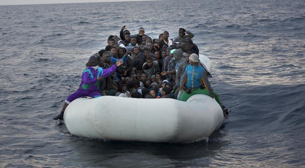 Migrants and refugees crowd on a rubber boat sailing out of control 21 miles north of Sabratha, Libya (AP)