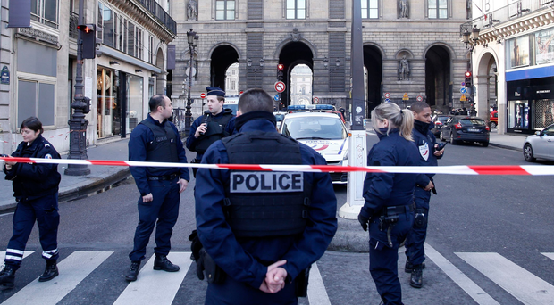 Police stand guard near the Louvre museum after the latest attack