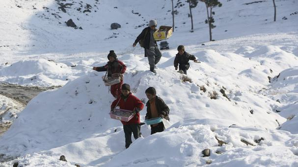 Avalanches and snowstorms kill scores in Afghanistan