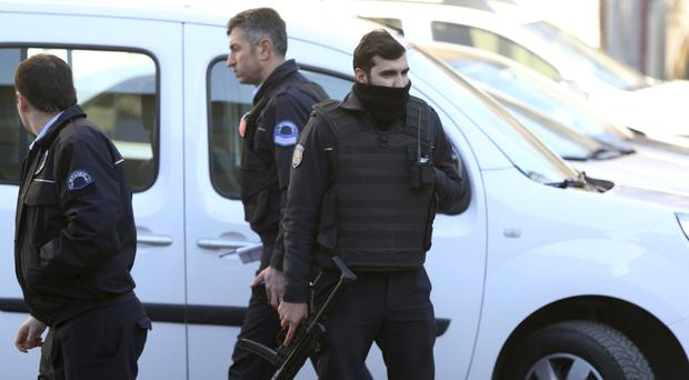 Armed police took part in raids across Turkey in a terror crackdown (Lefteris Pitarakis/AP)