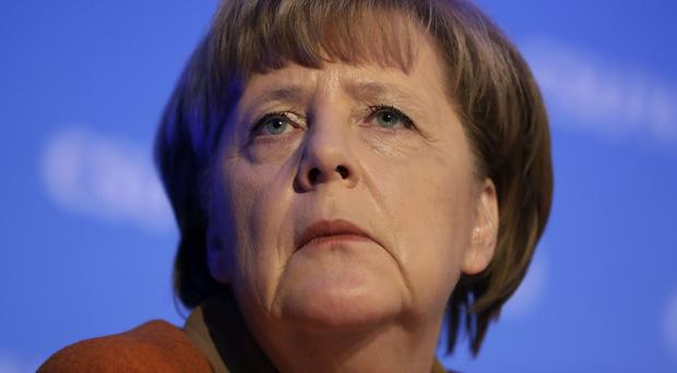 Mrs Merkel has been restrained in her comments on the new US administration so far (AP)