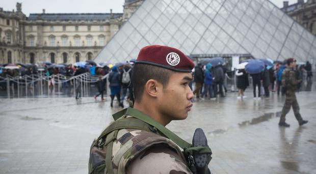 A soldier patrols the courtyard of the Louvre after the suspected terror attack (AP)