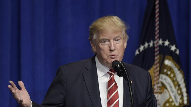 Stories shared on social media stating that President Donald Trump's travel ban led to the arrest of an Islamic State group leader at a New York City airport are false.. (AP/Susan Walsh)
