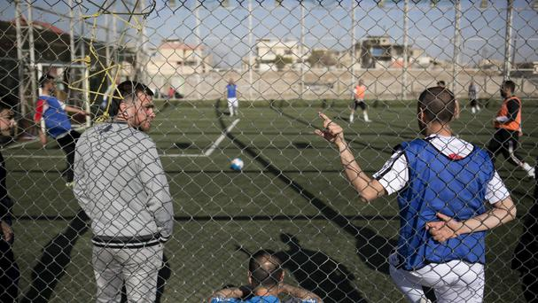 Mosul residents play football on a pitch in the liberated eastern part of the city (Bram Janssen/AP)