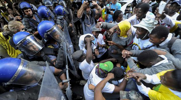 Protesters clash with police near parliament in Cape Town, South Africa (AP)