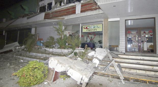 Fallen debris from a business following a powerful earthquake that rocked Surigao city in the southern Philippines (AP)
