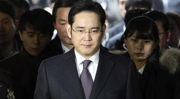 Special prosecutors have asked a court to issue an arrest warrant for Lee Jae-yong (AP)