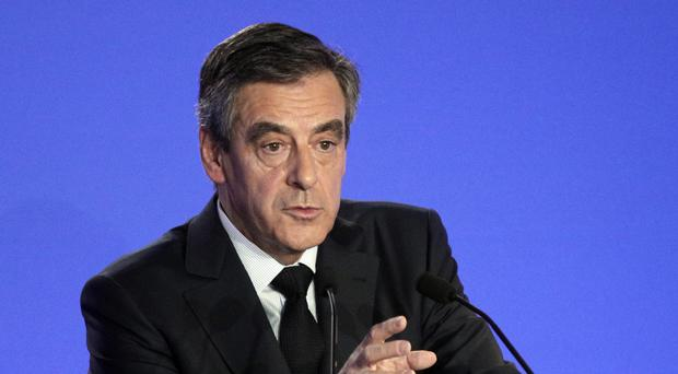 Francois Fillon has denied wrongdoing in employing family members and is sticking to his campaign (AP)