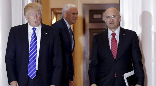 Donald Trump with Andrew Puzder, the nominee for secretary of labour (AP)
