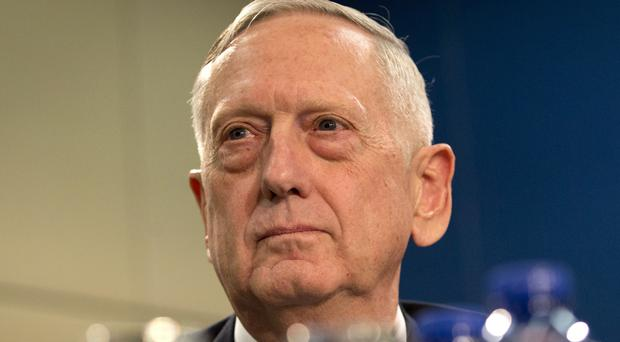 Jim Mattis said the US will continue to engage politically with Vladimir Putin's government to try to find common ground (Virginia Mayo/AP)