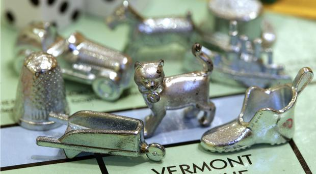 The thimble game piece is set to be ditched (Steven Senne/AP)