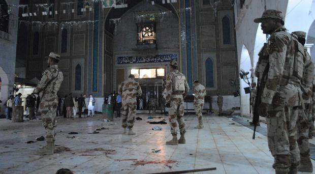 Pakistani para-military soldiers on guard after a deadly suicide attack at a shrine in Sehwan (AP Photo/Pervez Masih)