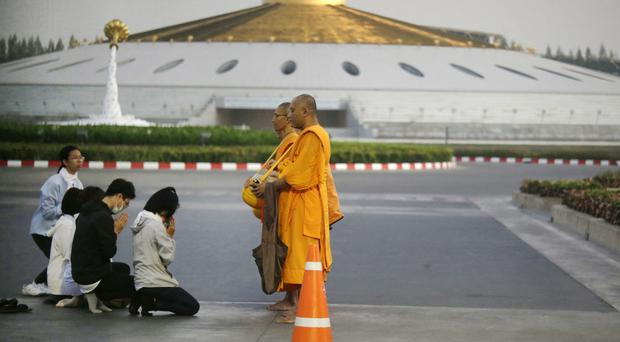 Buddhists pray to monks inside the Dhammakaya sect temple grounds in Thailand (AP Photo/Sakchai Lalit)