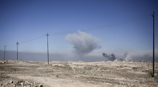 Smoke rises from the town of Abu Saif after air strikes hit Islamic State positions (AP/Bram Janssen)