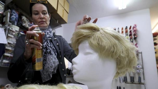 Manuela Plank fashions normal blond hairpieces into Trump wigs in Pfaffstaetten, Austria (Ronald Zak/AP)