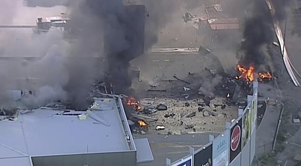 The plane crashed into the rear of the mall (Channel 9/AP)