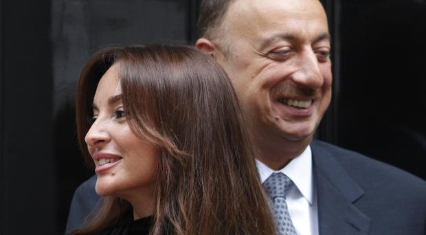 President Ilham Aliyev and his wife Mehriban Aliyeva on a visit to Downing Street (AP)