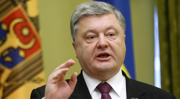 Petro Poroshenko said Moscow's action contradicted the 2015 peace agreement (AP)