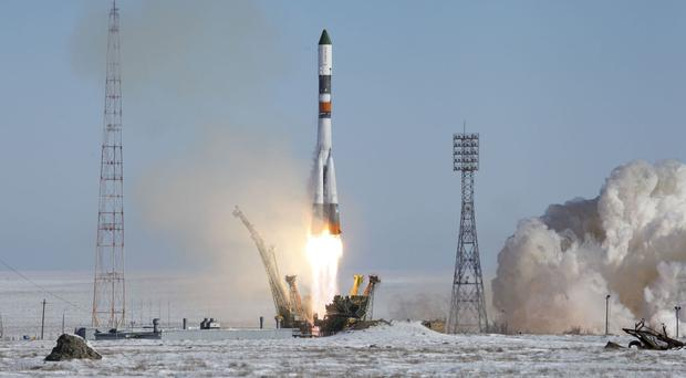A Soyuz-U booster rocket blasts off on a supply mission to the International Space Station (Russian Space Agency Roscosmos press service via AP)