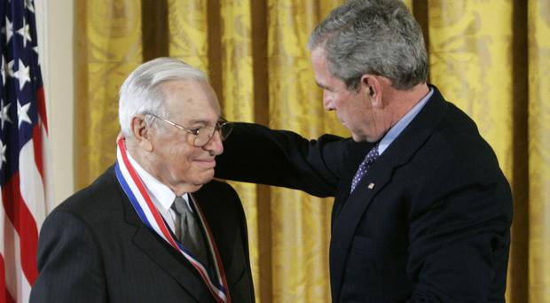US president George Bush, right, presents the National Medal of Science to Mr Arrow in 2006 (AP)