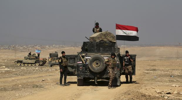 Iraqi special forces advance towards the western side of Mosul (AP/Khalid Mohammed)