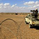A soldier stands at the border with Syria, where forces have been battling IS (AP/Raad Adayleh)