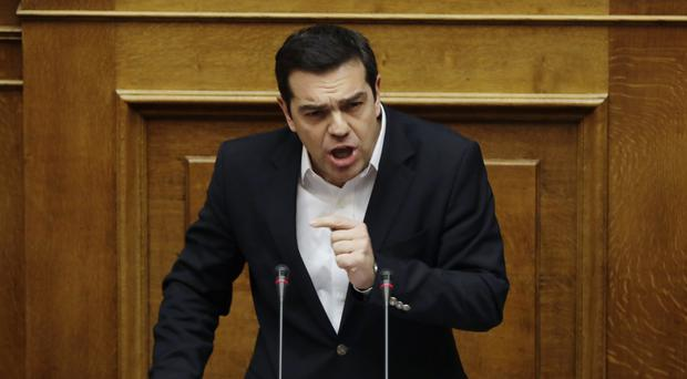 Greek Prime Minister Alexis Tsipras speaks during a parliament session about the bailout negotiations (AP/Thanassis Stavrakis)
