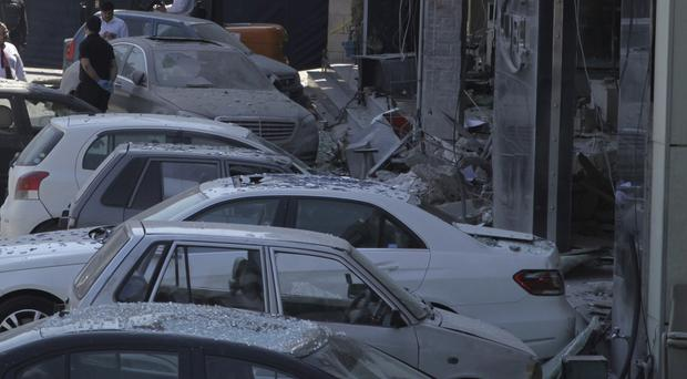Suicide attackers targeted a security building in Homs (AP)