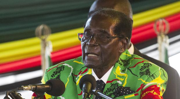 Zimbabwean President Robert Mugabe IS celebrating his 93rd birthday (AP)