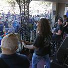 Cowboy Mouth performs for the crowd on the front porch of a home along the Krewe of Endymion parade route (AP)