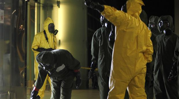 The decontamination zone at Kuala Lumpur International Airport is scanned for toxic chemicals (AP)