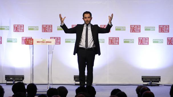 Benoit Hamon announced he was staying in the race (AP)