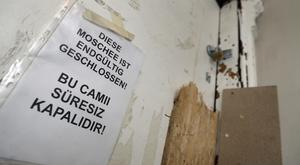 The entrance door of the closed Fussilet Mosque in Berlin (Michael Sohn/AP)