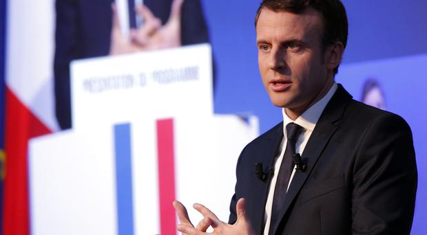 Independent centrist presidential candidate Emmanuel Macron addresses the media during a press conference held in Paris (Christophe Ena/AP)