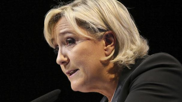 Marine Le Pen, in addition to being the leader of France's far-right National Front party, is also a politician with the European Parliament (David Vincent/AP)