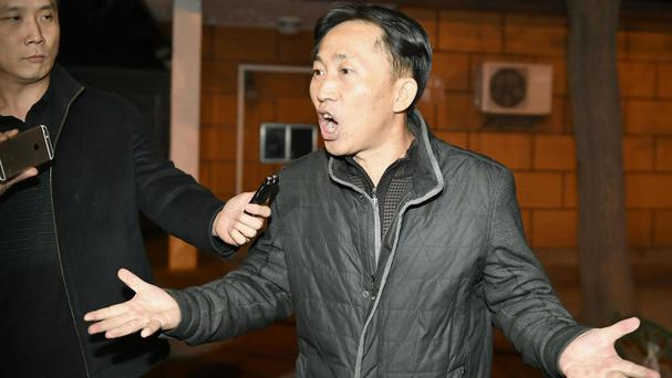 Ri Jong Chol speaks to reporters at the North Korean embassy in Beijing (Kyodo News/AP)