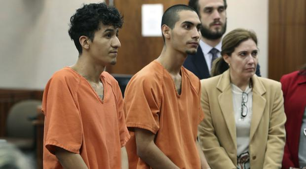 Miguel Alvarez-Flores and Diego Hernandez-Rivera appear in court in Houston (Houston Chronicle/AP)