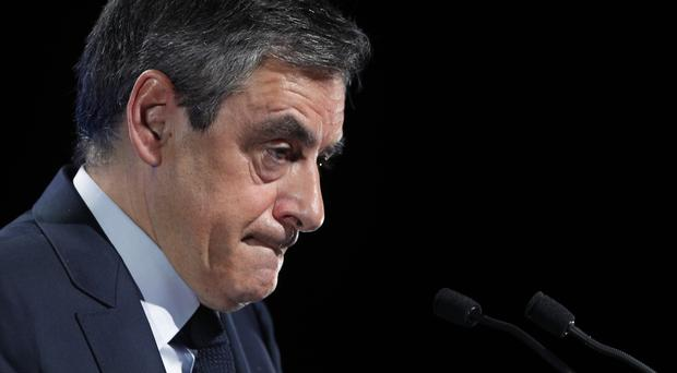 Francois Fillon delivers his speech during a campaign meeting in Aubervilliers, outside Paris (Christophe Ena/AP)