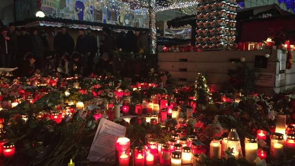 Candles are lit at Breitscheidplatz, in Berlin, in tribute to the twelve people who died