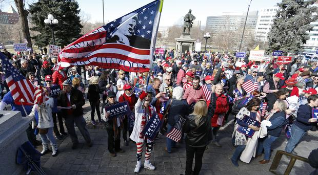 Supporters of Donald Trump gather for a rally on the state Capitol steps in Denver, Colorado (AP)