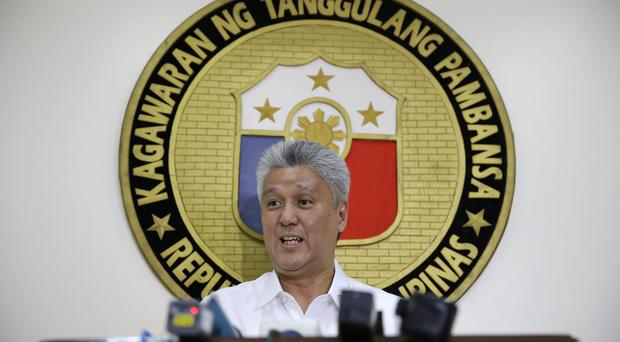 National Defence spokesman Arsenio Andolong talks to reporters in Quezon city (AP)
